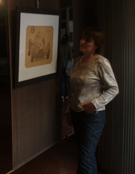 Claudia with framed work